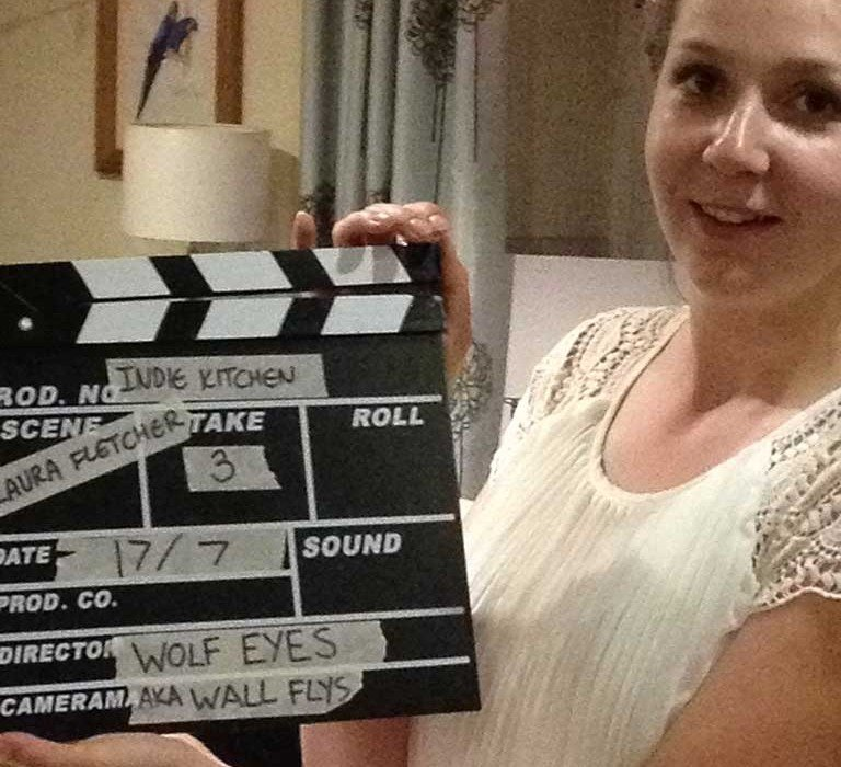 Laura Fletcher with clapper board